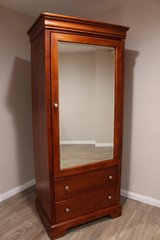 Wardrobe with Two Drawers and Hanging Rod in CyFair, Texas