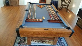 pool table 7 ft. slate with 11 sticks, wall stick holder,balls,chalk in Cherry Point, North Carolina