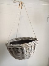 Large white basket with inner pot for hanging plants in Ramstein, Germany