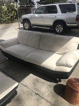 Black and white leather couch and chair in Travis AFB, California