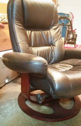 Leather chair with matching leather footstool in Batavia, Illinois