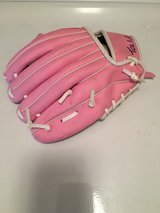 Pink child baseball glove, pink plastic bat and some balls in Wheaton, Illinois