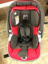 Red infant car seat and base (Peg Perego Primo Viaggio) in Aurora, Illinois