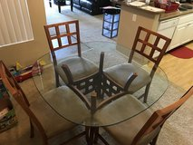 Glass top dining table with chairs in Camp Pendleton, California