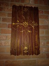 Fleur de lis metal cross on wood decor in The Woodlands, Texas