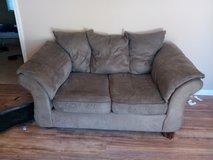 Brown microfiber couch in Kingwood, Texas