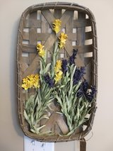 Beautiful wood basket with yellow and purple flowers in Pleasant View, Tennessee