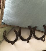 Vintage horseshoes hand forged into a hanging rack in Beaufort, South Carolina