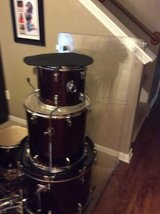 Red drum set with pads and sound proof walls in The Woodlands, Texas