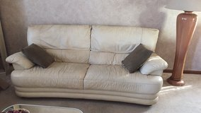 2 cream colored leather couches in Bolingbrook, Illinois