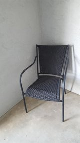 4 black outdoor chairs. in San Clemente, California