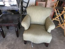 2 green upholstery green arm chairs in 29 Palms, California