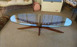Oval glass coffee table in Fort Belvoir, Virginia
