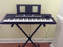 Yamaha keyboard with stand in Warner Robins, Georgia