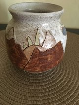 Handmade pottery with mountains, sun, clouds in Chicago, Illinois