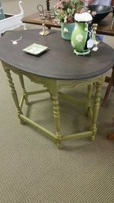 Antique green parlor table in Fort Leonard Wood, Missouri