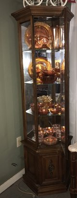 curio cabinet with antique glassware in Conroe, Texas