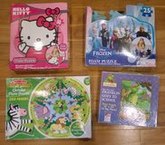 Set of 4 children's floor puzzles Hello Kitty Frozen zoo animals and Franklin in Bolingbrook, Illinois