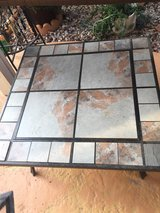 Table/Firepit with fire poker, log rack & safety mesh screen in Oceanside, California