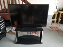 Sharp 60 inch TV with TV stand and entertainment center in Camp Lejeune, North Carolina