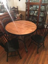 Round solid wood table and chairs in Fort Benning, Georgia