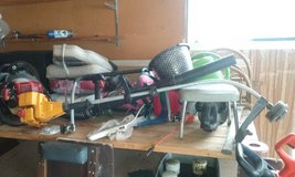 Work benches full of things, edger, leaf blower ect. in Fort Drum, New York