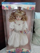 Collectible porcelain doll in box in Conroe, Texas