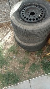 Set of tires and rims with covers in Alamogordo, New Mexico
