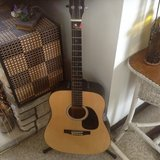 Acoustic guitar with stand in Fort Drum, New York