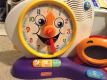Fisher price teaching clock in Warner Robins, Georgia