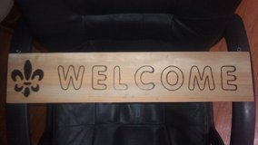 Wood burned welcome sign in Fort Polk, Louisiana