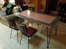 7 pc Hoffman Table Co. Mid century modern pink & gray hairpin leg table & 6 Red Studded chairs in Naperville, Illinois