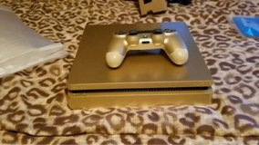 PlayStation 4 Slim Gold available for sale with bunch of games. in Algonquin, Illinois