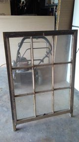 large vintage wooden window with legs in Kingwood, Texas