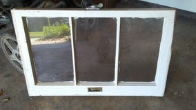 small vintage rectangular wooden window in Cleveland, Texas