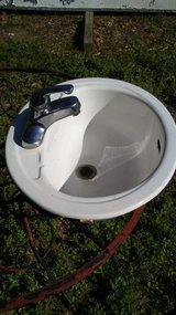 Small vintage porcelain sink in Kingwood, Texas