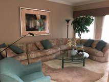 Gorgeous modern sectional couch with cocktail table, rug and lamp in Westmont, Illinois