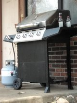 Bbq grill with brand new propane tank never been used in Fort Leonard Wood, Missouri
