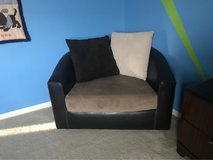 Leather swivel chair with micro fiber cushion and pillows in Temecula, California