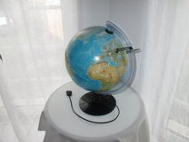 globe with light and magnifying glass in Ramstein, Germany