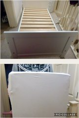 white toddler bed with mattress in Lakenheath, UK