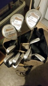 golf clubs with bag and new balls in Fort Leonard Wood, Missouri