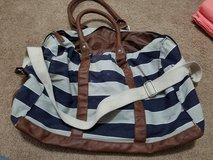 Duffle bag with crossbody strap in Naperville, Illinois