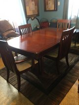 Formal dining set 6 chairs 1 leave has a few scratches on chairs easily fixed in Houston, Texas