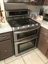Gas stainless steel, 5 burner range, double oven and microwave combo in Aurora, Illinois