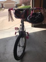 Tink bike w/ helmet in Fort Carson, Colorado