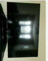 """Samsung 58"""" LED SmartTV with wall mount in Fort Campbell, Kentucky"""