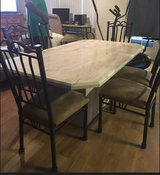 Solid marble dining room table with Iron chairs in 29 Palms, California