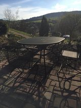 Metal patio table with four chairs and umbrella in Ramstein, Germany