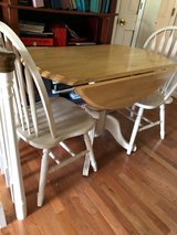 Drop leaf round pedestal table w/2 chairs in Fort Campbell, Kentucky